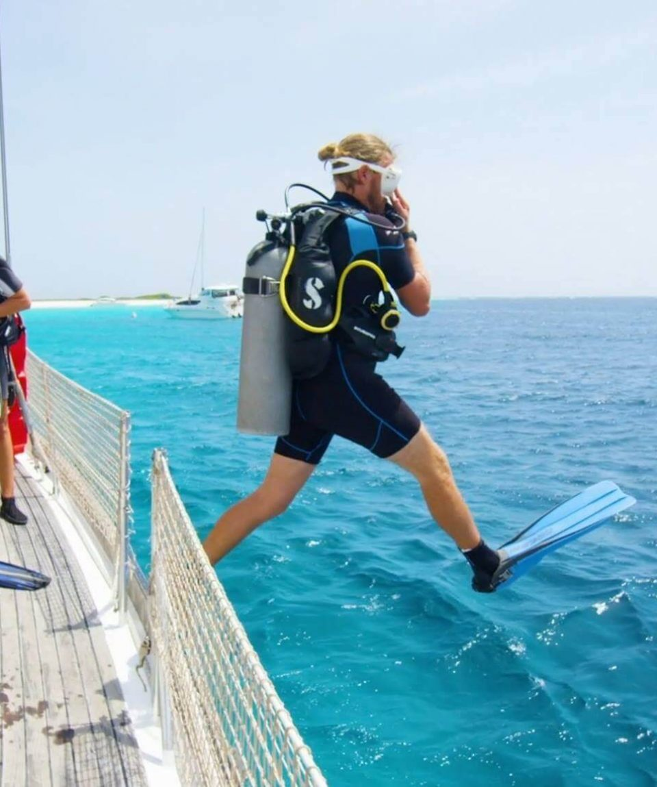 Klein-Curacao-Deals-Diving-from-Sailboat